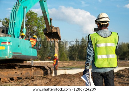 Construction engineer or civil engineer take a photo by smart phone for daily report