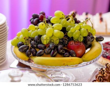 Fruit and candy bar close up #1286753623