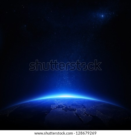 Earth at night with city lights (Elements of this image furnished by NASA) #128679269