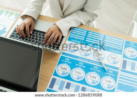 Business women reviewing data in financial charts and graphs. Accounting #1286859088