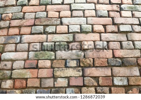 Brickwork is masonry produced by a bricklayer, using bricks and mortar. Typically, rows of bricks are laid on top of one another to build up a structure such as a brick wall. #1286872039