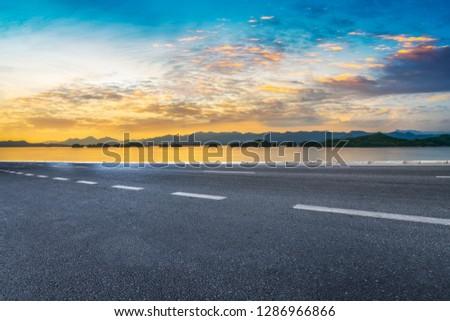 Highway Asphalt Pavement and Natural Landscape #1286966866