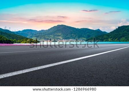 Highway Asphalt Pavement and Natural Landscape #1286966980