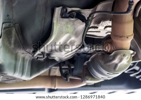 Close up oxygen sensor on Catalyst pipe of gasoline engine car on the hoist lift for service and repair in Garage shop #1286971840
