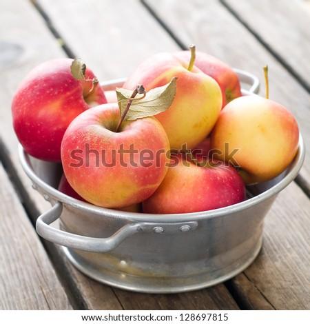 Fresh ripe apples in bowl, selective focus #128697815