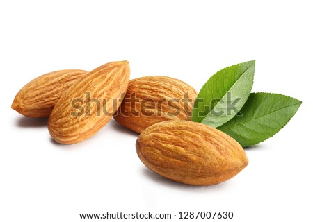 Close-up of almonds with leaves, isolated on white background #1287007630
