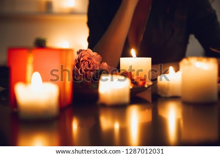 Close up of a woman sitting at the candlelight table #1287012031