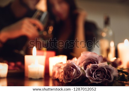 Beautiful passionate couple having a romantic candlelight dinner at home, drinking wine, toasting #1287012052