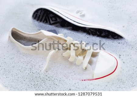 Soak shoes before washing. Cleaning Dirty sneakers. #1287079531