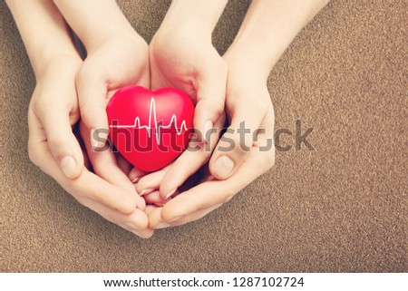 Close-up red Heart in hands, love concept #1287102724