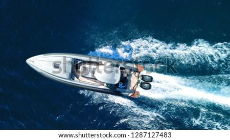 Aerial top view luxury inflatable rib speed boat cruising in mediterranean deep blue sea #1287127483