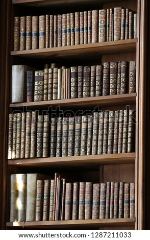 Vienna - March 10 2016: old books on wooden shelf in the national library of Vienna, 10 march 2016, Vienna, Austria. #1287211033