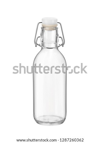 Small empty glass swing top bottle isolated on white background. Side view. #1287260362