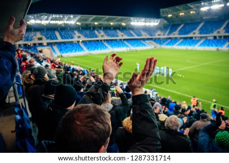 Fans on football, soccer stadium game #1287331714