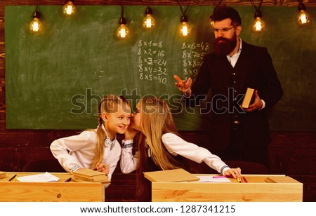 childhood in school. childhood of little girls in school. spend childhood in school. childhood in school for two pertty friends. happy children #1287341215