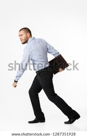 bearded businessman with leather case running on white background #1287351928