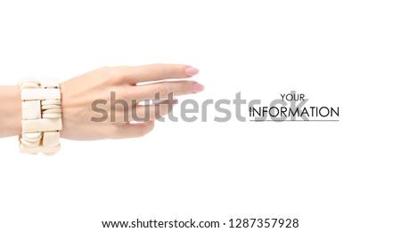 Bijouterie bracelet ivory stone in hand pattern on white background isolation #1287357928