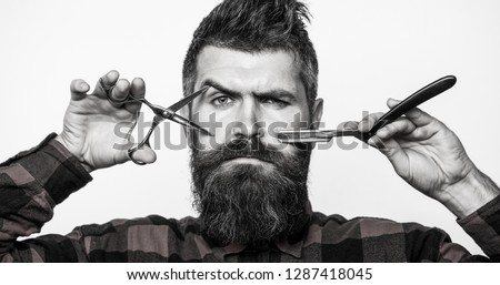 Man in barbershop. Bearded man, lush beard, handsome. Hipster, brutal male.  Mens haircut. Vintage barbershop, barber shop, shaving. Barber scissors. Mens haircut. Black and white. #1287418045