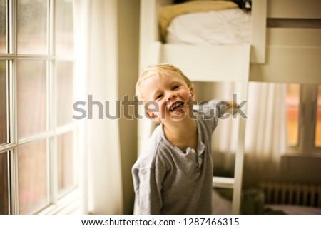 Boy next to his bunk beds