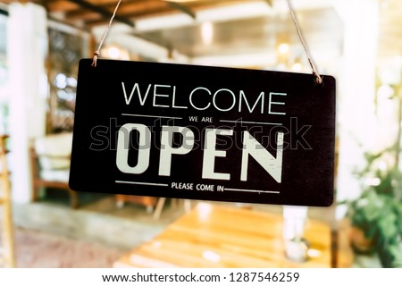 Welcome open sign use for any business in front of shop or online background. #1287546259