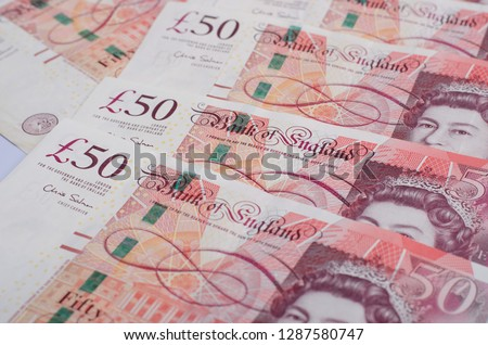 UK pound,money of United kingdom close up on white, Pound UK note #1287580747