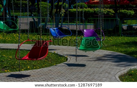In the amusement park, an old carousel on chains #1287697189