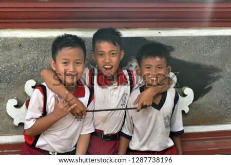 NUSA PENIDA - INDONESIA / 06.12.2018: Smiling school kids from Nusa Penida Island in their school uniform, Indonesia #1287738196