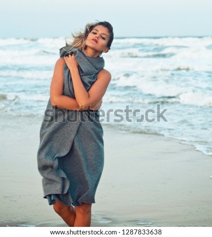 young pretty woman in sweater at seacoast walking relaxing #1287833638