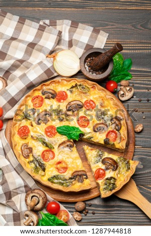 Traditional french Baked homemade quiche pie on wooden board #1287944818