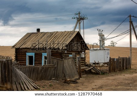 Old abandoned wooden house. Ruin and desolation. Village. Russian countryside, landscape #1287970468