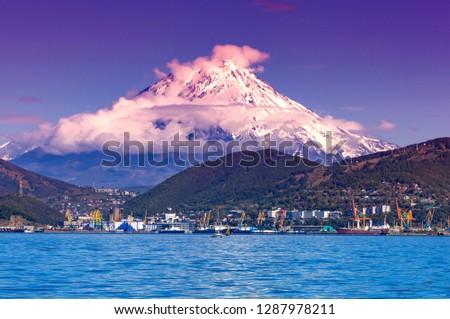 Panoramic view of the city Petropavlovsk-Kamchatsky and volcanoes: Koryaksky Volcano, Avacha Volcano, Kozelsky Volcano. Russian Far East, Kamchatka Peninsula #1287978211