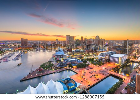 Baltimore, Maryland, USA city skyline over the Inner Harbor at twilight.