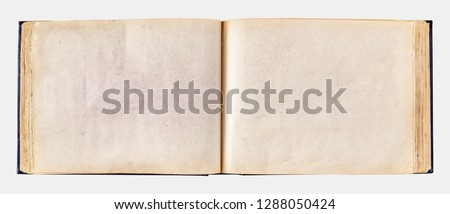 old yellowed photo album for photos. Copy space for your photos or text