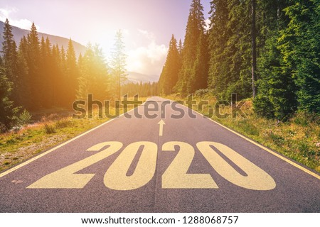 Empty asphalt road and New year 2020 concept. Driving on an empty road in the mountains to upcoming 2020 and leaving behind old 2019. Concept for success and passing time. #1288068757