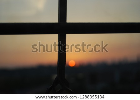 from the window one can see an iron cross and sunset, a summer hot evening. God works in mysterious ways #1288355134