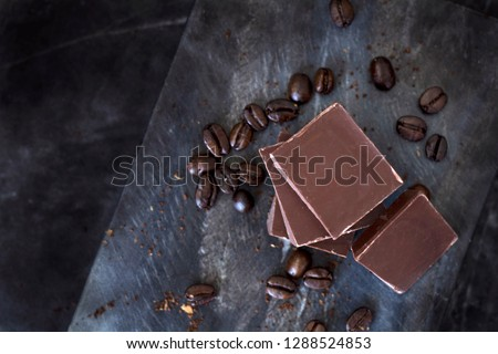 Milk Chocolate bar with coffee beans representing mocha coffee or hand baking in the kitchen #1288524853