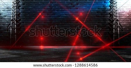 Dark room, a tunnel, a corridor with rays of light and a red laser beam of red color, smoke, smog, dust. Abstract dark blue background with light effect, neon.  #1288614586
