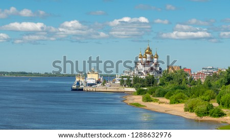 City of Arkhangelsk, Russia. Orthodox Cathedral on the banks of the river. Ships are at the pier. Beautiful summer day. #1288632976