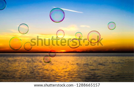 Soap bubbles sunset river landscape. Sunset soap bubbles background. Soap bubbles sunset scene #1288665157