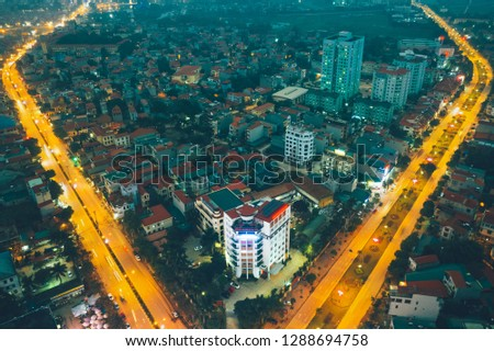 Vinh Phuc, Vietnam January 17, 2019: The intersection of Vinh Yen city in Vinh Phuc province in the evening is seen from above. #1288694758