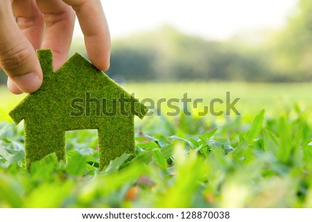 Hand holding eco house icon concept Royalty-Free Stock Photo #128870038