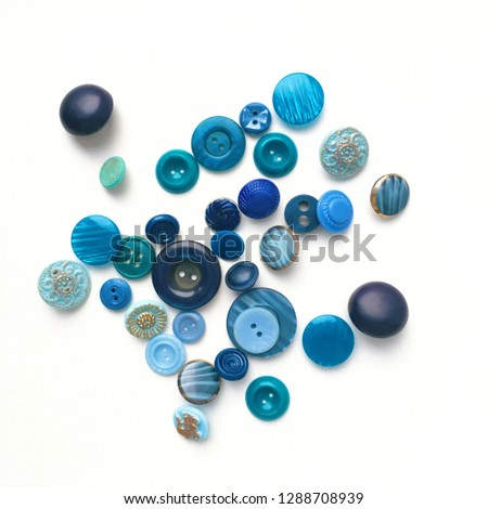Blue buttons scattered across a white background #1288708939
