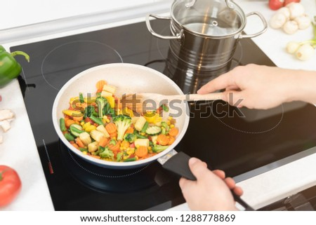 Fresh vegetables fried in a pan. Healthy nutrition concept. Healthy nutrition concept #1288778869