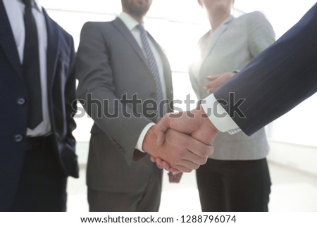 business leader shaking hands with the investor #1288796074