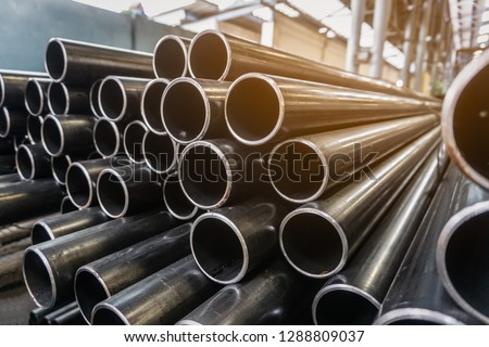 high quality Galvanized steel pipe or Aluminum and chrome stainless pipes in stack waiting for shipment  in warehouse #1288809037