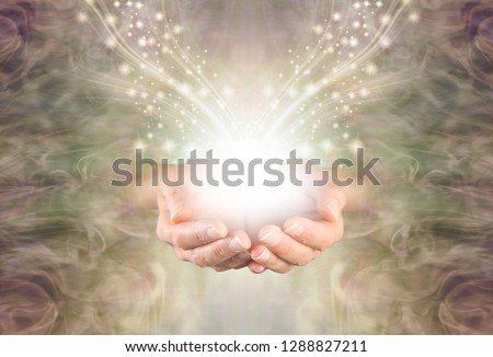 Sending You High Resonance Healing Energy - female cupped hands emerging from a green gold swirling energy field background with shimmering sparkles and white light flowing outwards                   #1288827211