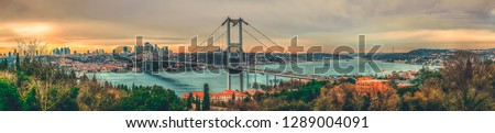Istanbul Bosphorus panoramic photo. Istanbul landscape beautiful sunset with clouds Ortakoy Mosque, Bosphorus Bridge, Fatih Sultan Mehmet Bridge Istanbul Turkey.Best touristic destination of Istanbul #1289004091