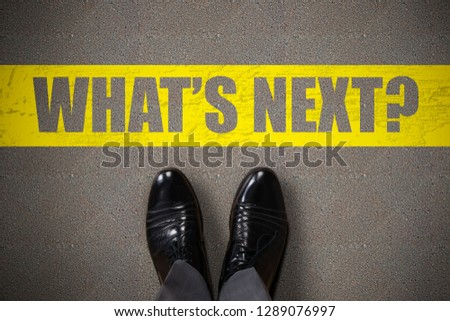 Person's Standing Next To What's Next Text On Asphalt Background #1289076997