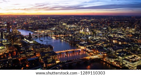 Bird's eye view over London city illuminated at dusk with view of St Pal's cathedral #1289110303