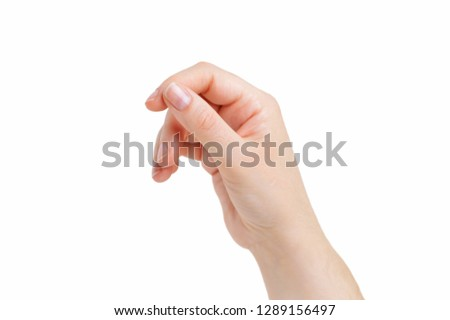 Woman hand hanging something blank isolated on a white background #1289156497